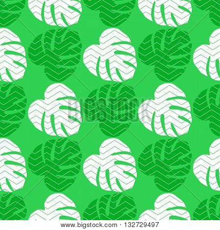 Seamless texture with flat green and white leaves. Monstera.Patterns for cloth
