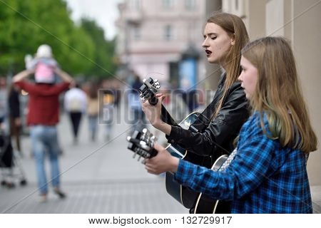 VILNIUS LITHUANIA - MAY 21: Unidentified musician plays guitar in Street music day on May 21 2016 in Vilnius. Its a most popular event on May in Vilnius Lithuania