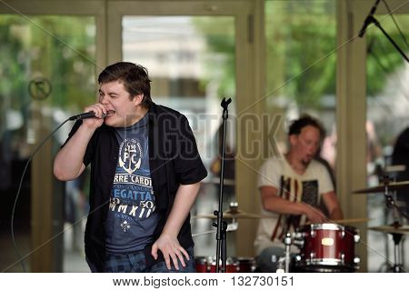 VILNIUS LITHUANIA - MAY 21: Unidentified young musician sings in Street Music Day on May 21 2016 in Vilnius. Its a most popular event on May in Vilnius Lithuania