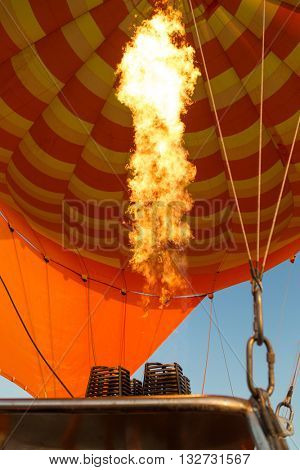 Hot air balloon burner directing a flame into the envelope.