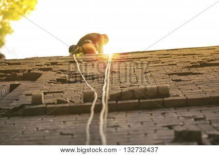 Professional wall climber climbs a stone wall
