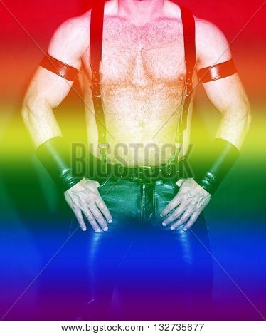 muscular male torso dressed in fetish black leather with rainbow colors for gay pride