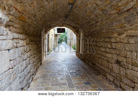 BUDVA MONTENEGRO - SEPTEMBER 18 2015: Stone vaults of arch on street of Old town of Budva Montenegro