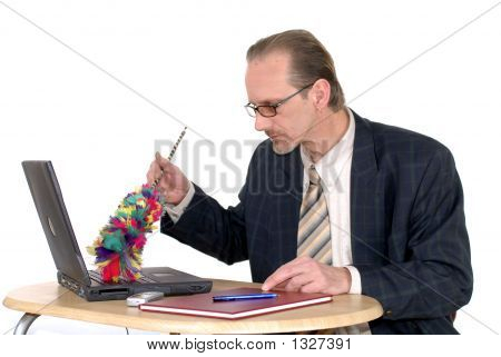 Businessman Cleaning Up Laptop