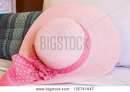 Close up of pink hat on couch