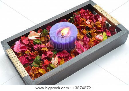 close upThe aromatherapy candles and dried flowers.