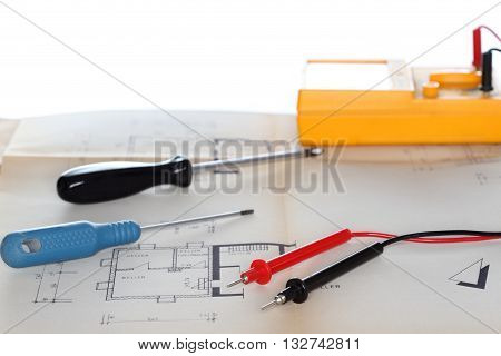some tools and a plan on a desk