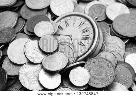 Bunch of old coins with a vintage watch.