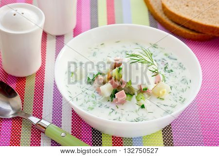 Okroshka - russian kvass cold soup with sour cream vegetables and sausage