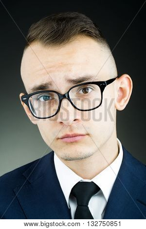Emotional Young Guy In Glasses