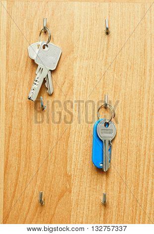 Keys on a wooden board , vertical image.