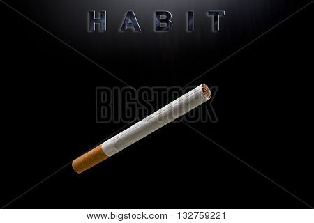 cigarette and text habit on black background