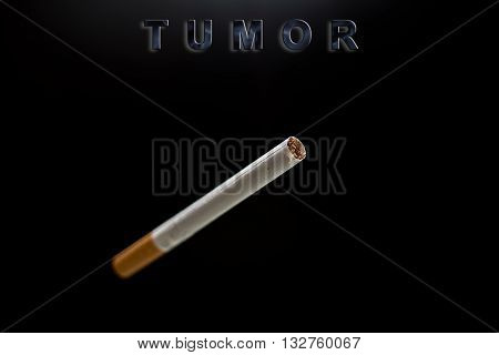 Only one cigarette text tumor on black background