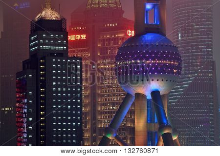 SHANGHAI CHINA - MARCH 19: Pudong district night view from Suzhou Creek on March 19 2016 in Shanghai China. Pudong is a district of Shanghai located east of the Huangpu River.