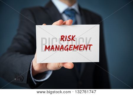 Risk management concept. Businessman or risk manager hold card with text risk management.