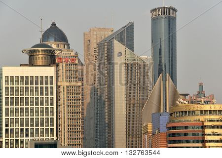 SHANGHAI CHINA - MARCH 25: Pudong district skyscrapers view from The Bund waterfront area on March 25 2016 in Shanghai China. Pudong is a district of Shanghai located east of the Huangpu River.