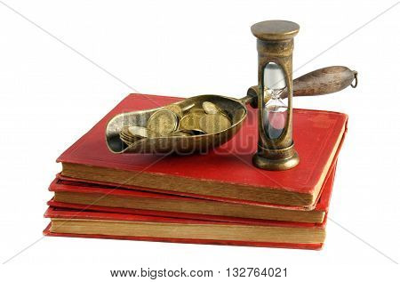 Book, coins and hourglass as symbols of knowledge time and money - successful business concept - isolated on white background
