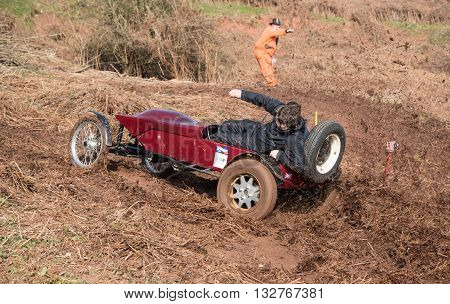 Worcester UK - March 13 2016 : Competitors take part in a hill climb to see who can drive their car furthest up a muddy hillside. This was a free to enter event with no photography restrictions.