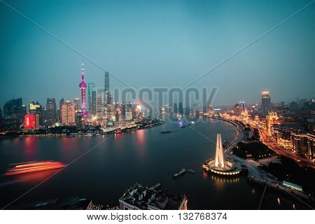 Panorama view of Shanghai city scape at night time.