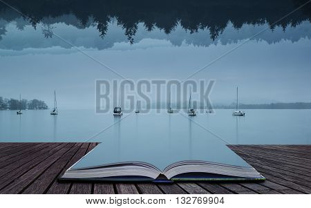 Stunning impossible enigmatic conceptual landscape image of lake and forest opposite each other vertically