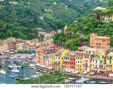 Aerial view of Portofino, a famous vacation resort with a picturesque harbor, luxury yachts and celebrity. Italian fishing village, provinces Genoa, Italy.