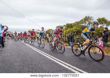 MELBOURNE, AUSTRALIA - FEBRUARY 1: The peloton passes the famous landmark of Bells Beach in the inaugral Cadel Evans Great Ocean Road Race