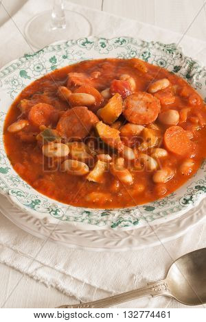 Tuscan bean soup made with cannellini beans zucchini and Italian sausage