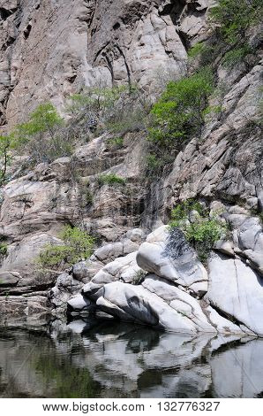A rocky outcropping within the Heilong Pond area of the Lakeside Great wall scenic area in Beijing China.