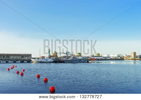 Ships On Venta River In Ventspils In Latvia