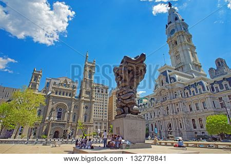 Square With A Sculpture And Philadelphia City Hall