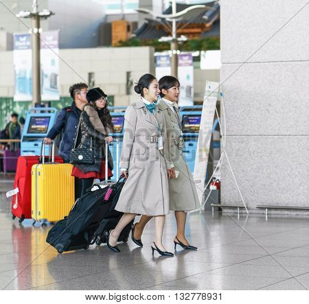 Incheon South Korea - February 15 2016: Two Asian Korean female air flight attendants at Incheon International airport. It is one of the largest and busiest world airports.