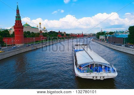 View of Moscow Kremlin and big barge on river, Russia