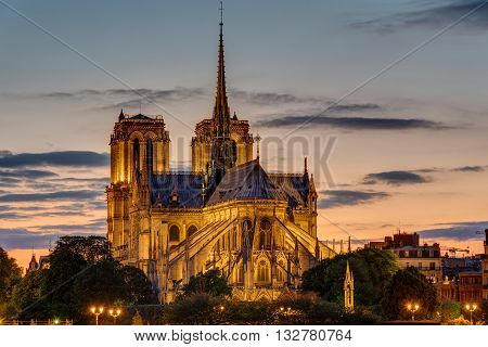 The backside of the famous Notre Dame cathedral in Paris at dawn