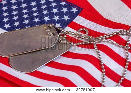 Dog Tags with chain laid out on American Flag