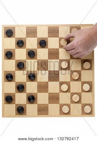Hand Playing On A Wooden Checker Board
