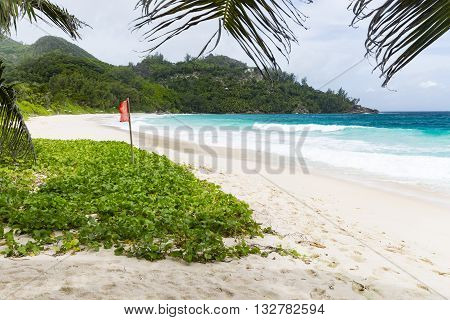 Red Flag At Anse Intendance, Mahe, Seychelles