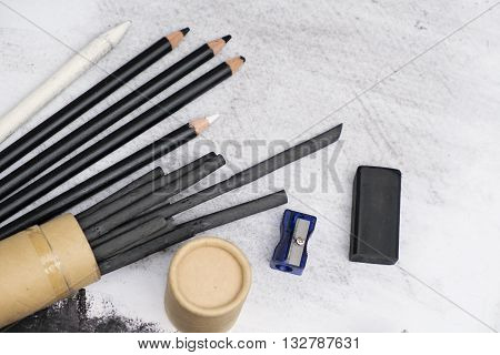 The Charcoal painting equipment on white canvas