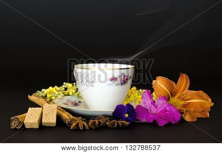 herbal tea, hot drink, drinking, diet, health, taste, cup, spices, cinnamon, star anise, brown sugar, sugar cube, lily, violet, azalea, black background, teas, purifying.