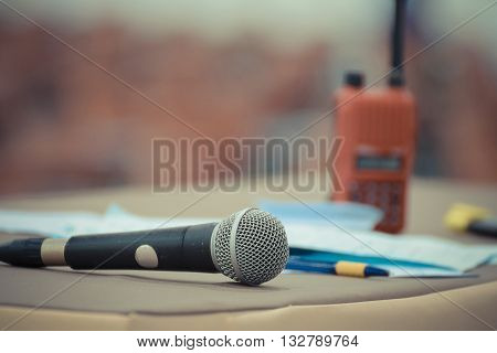 Microphone in seminar event defocus on walkie talkie (radio communication) and meeting room background