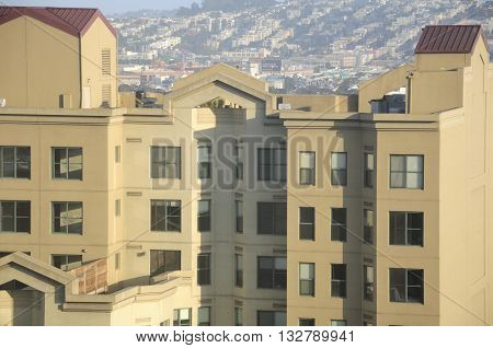 An apartment building in the city of San Francisco in the late afternoon.