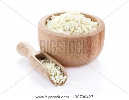 Sago in wooden bowl isolated on white background