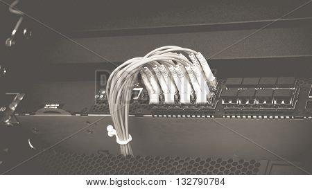 Network switch HUB and fiber optic cable in datacenter process in vintage black and white style.