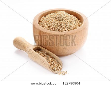 Wheat groats fine grind in wooden bowl isolated on white background