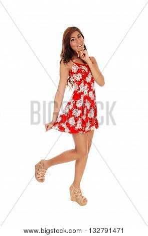 A lovely happy young woman standing in front in a red dress smiling isolated for white background.