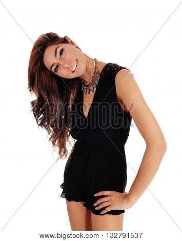 A pretty young woman in black jump suit standing from front with her heat tilt isolated for white background.