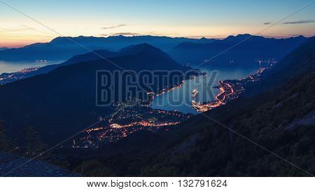 Bay of Kotor night panorama with historical Kotor old town and the Boka-Kotorska bay rocky shores. Montenegro