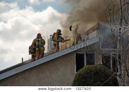 Fire Fighters On A Roof