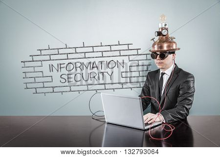 Information security concept with vintage businessman and laptop at office