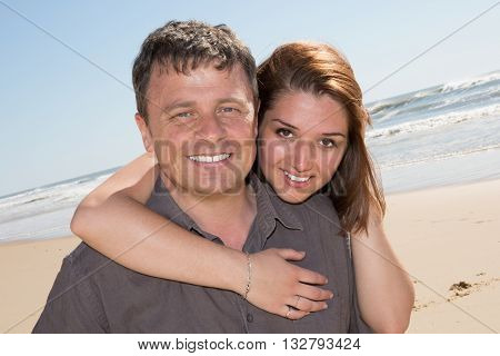 Smiling Couple In Love On The Beach Flirting