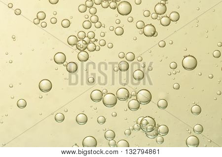 Golden air bubbles in a glass og cold champagne